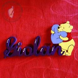 Plaque de porte avec Winnie l'Ourson et son coussin